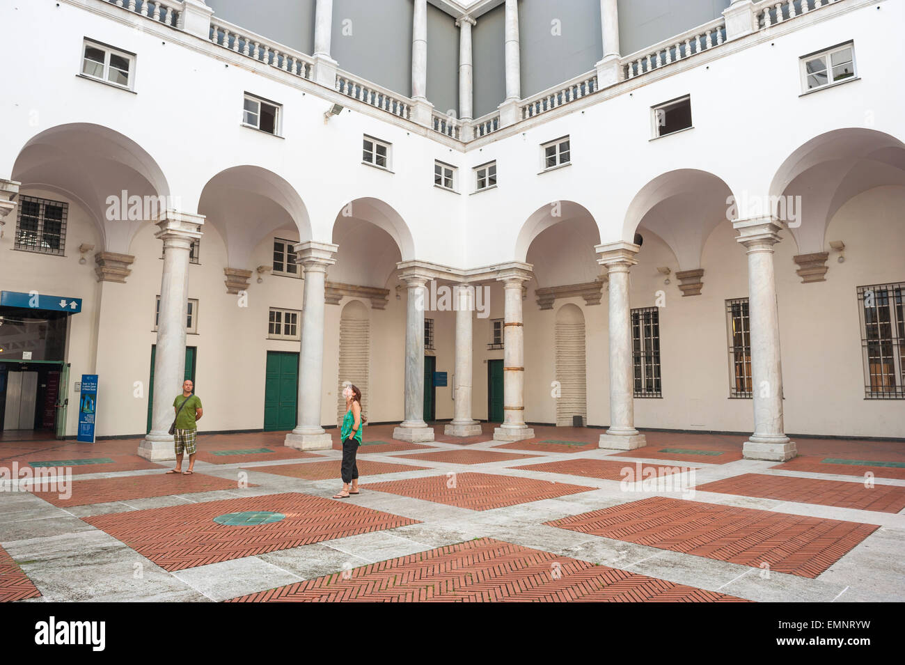 Genoa museum, tourists in the Palazzo Ducale in Genoa pause to appreciate the architecture of its courtyard, Genova, Stock Photo
