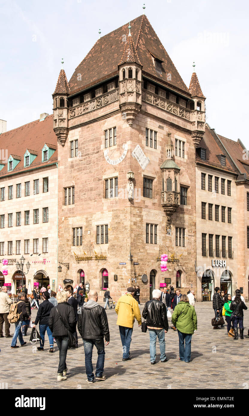 NUERNBERG, GERMANY - APRIL 9: Tourist at the Nassauer Haus in Nuernberg, Germany on April 9, 2015. The medieval - Stock Image