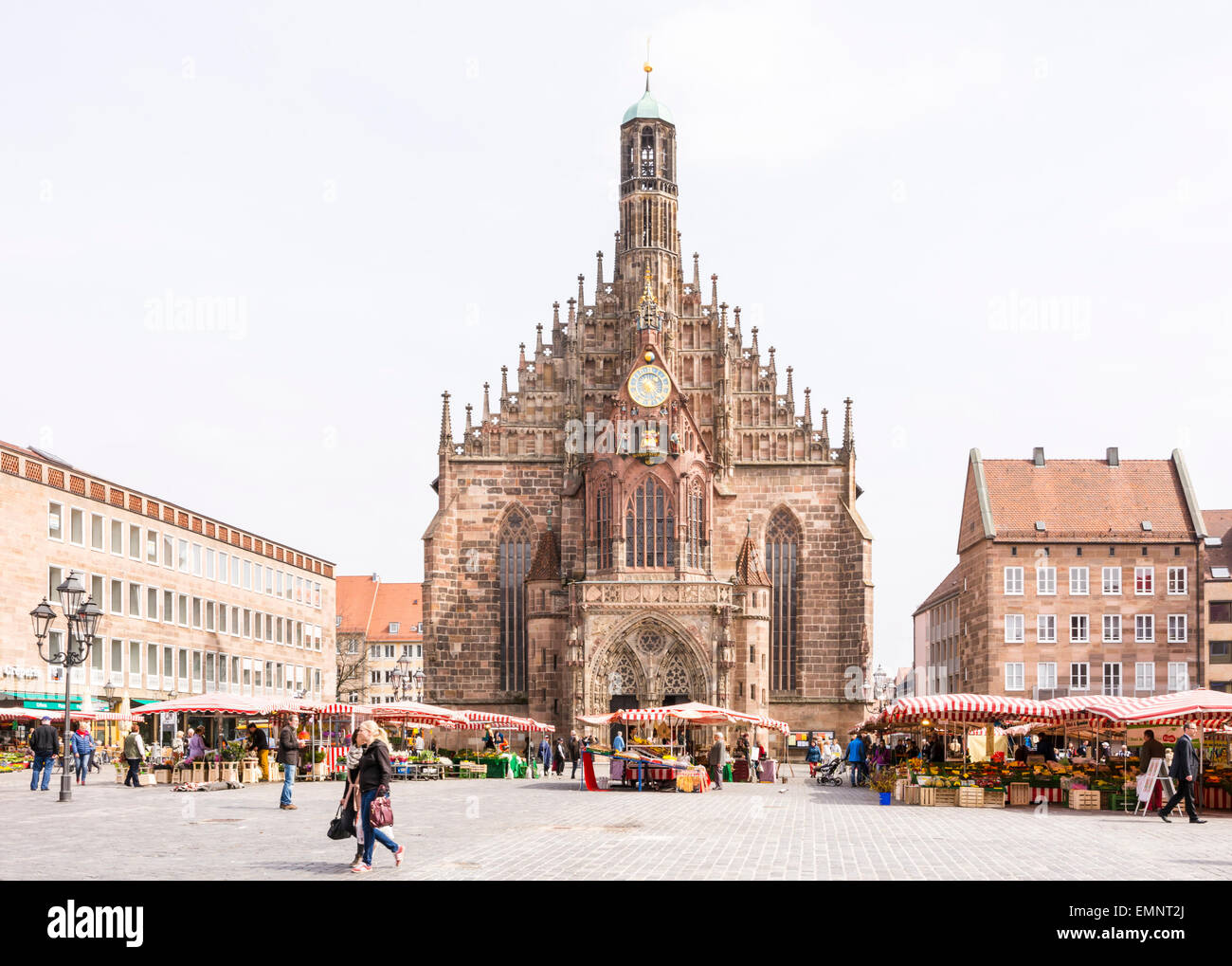 NUERNBERG, GERMANY - APRIL 9: Tourist at the Frauenkirche in Nuernberg, Germany on April 9, 2015. The church is Stock Photo