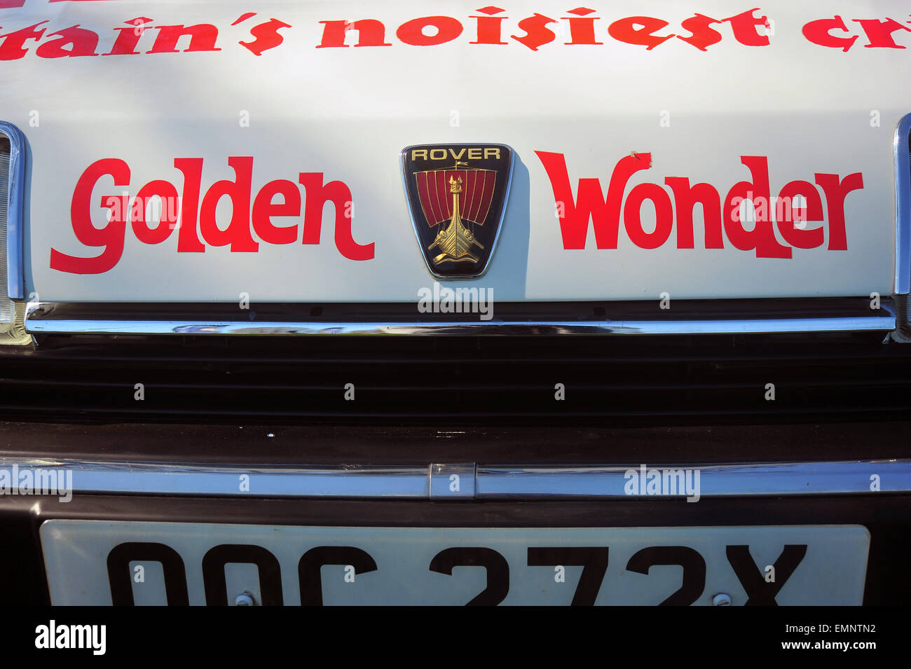 A close view of the badge of a Rover car with Golden Wonder sponsorship on it. - Stock Image