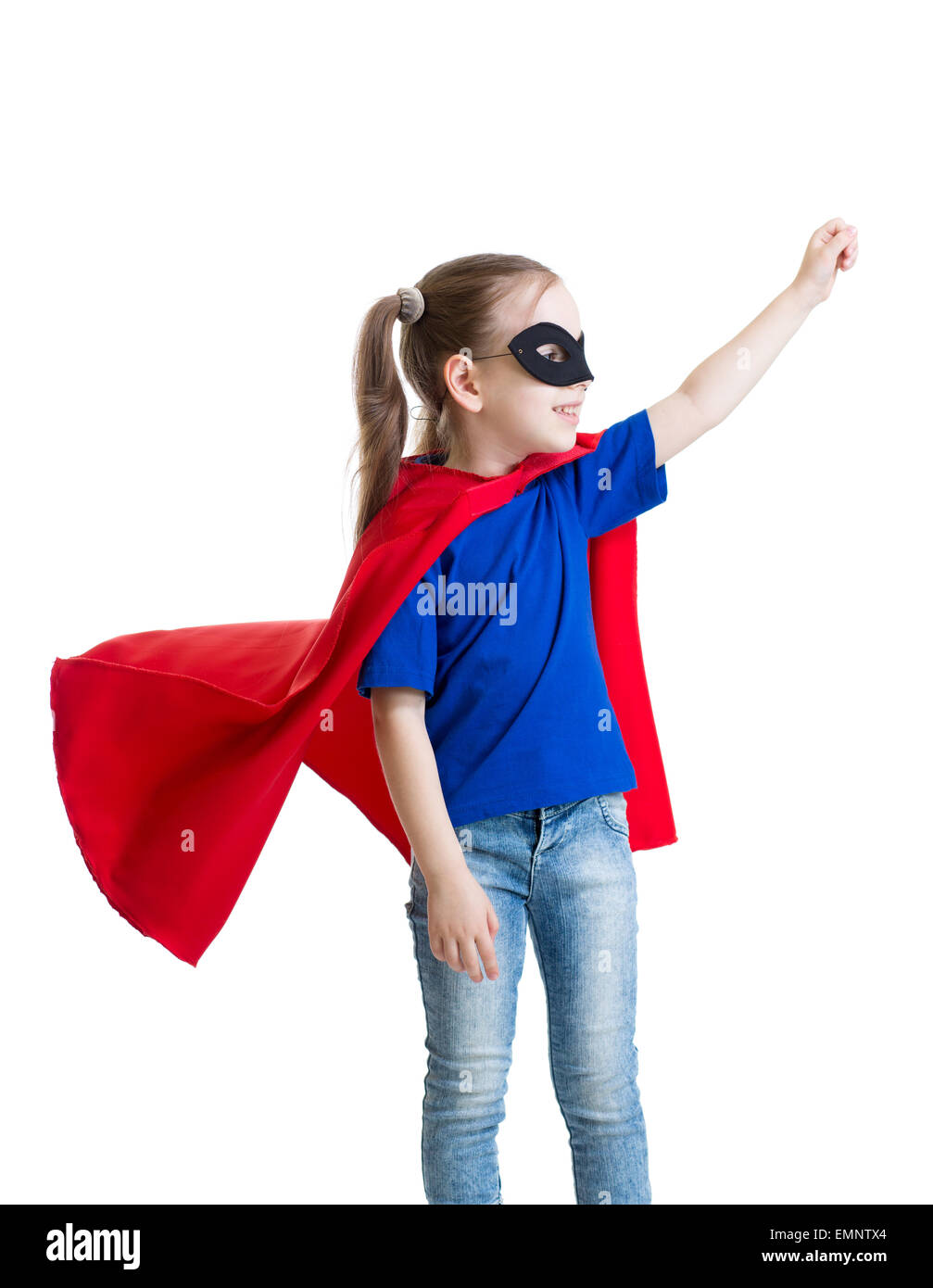 little power super hero child in red raincoat - Stock Image
