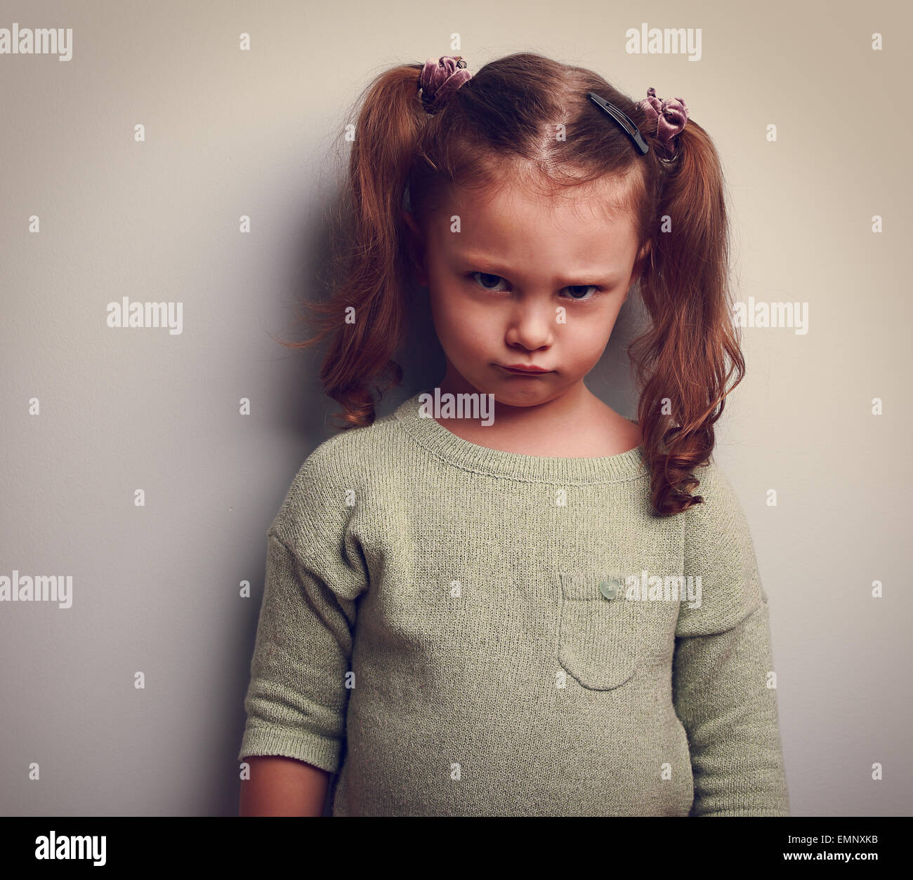Upset angry girl looking with very emotion face. Closeup portrait - Stock Image