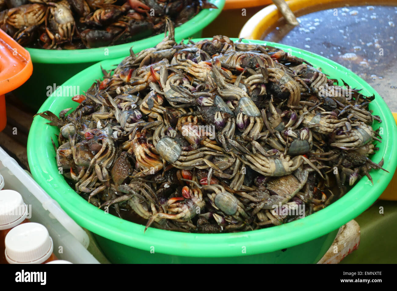 Small dead crabs for sale on a stall in a Bangkok food market - Stock Image