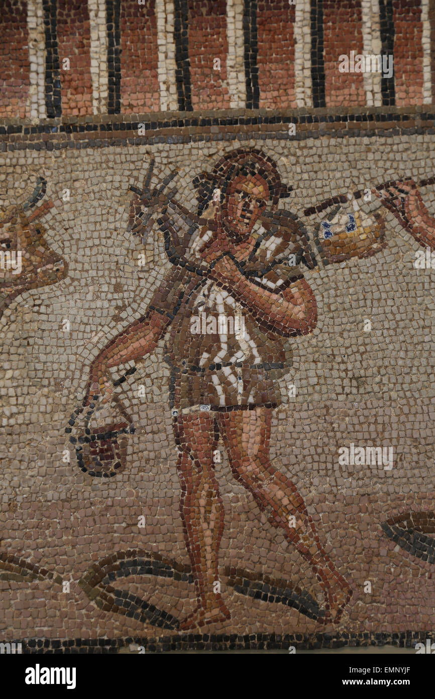 Roman mosaic with marine and rural scenes. Late Imperial, late 2nd-3rd C. AD. Detail. Workman with short tunic. - Stock Image