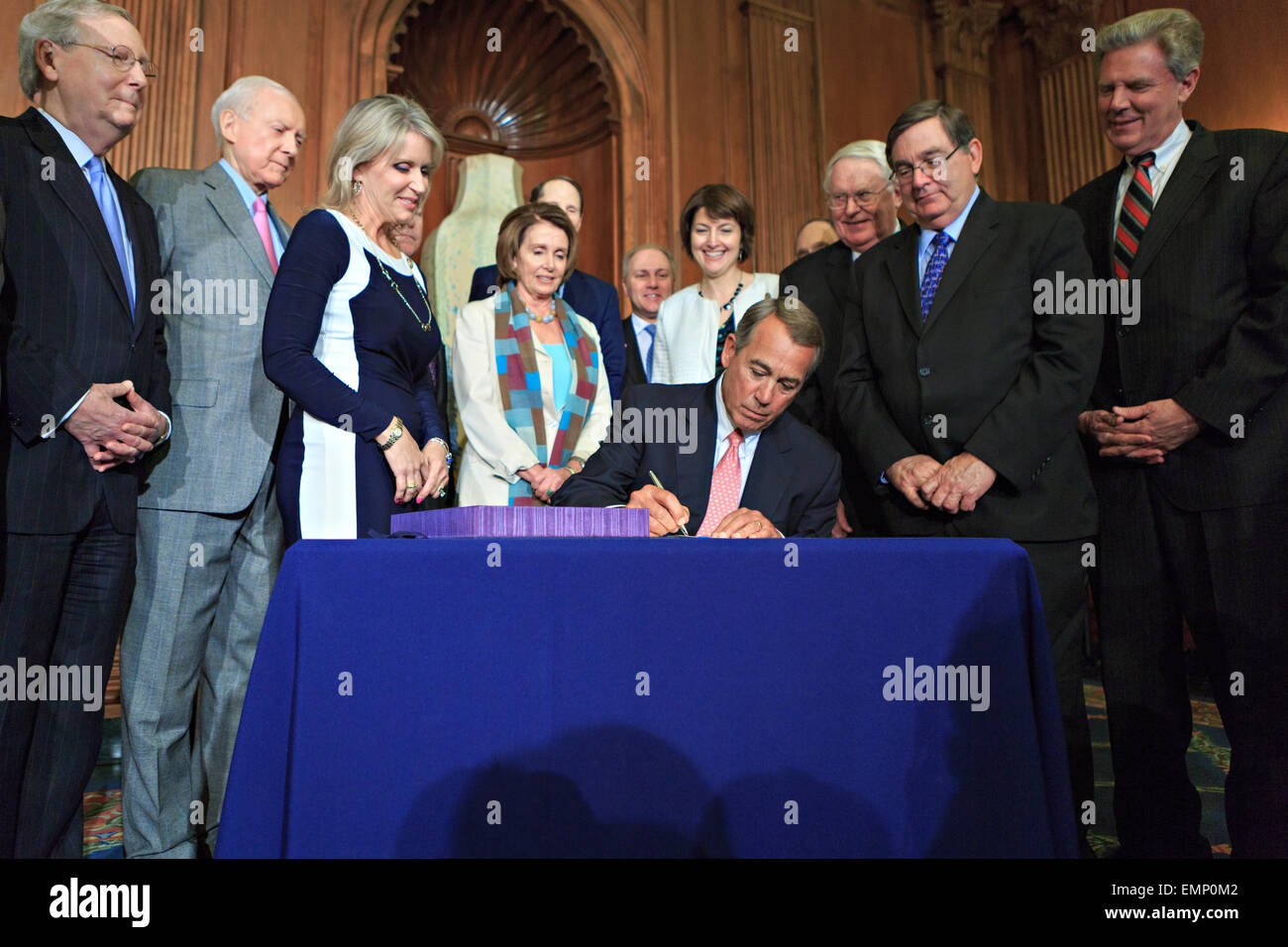 US Speaker of the House John Boehner is joined by a bipartisan group of House and Senate leaders to sign H.R. 2, - Stock Image