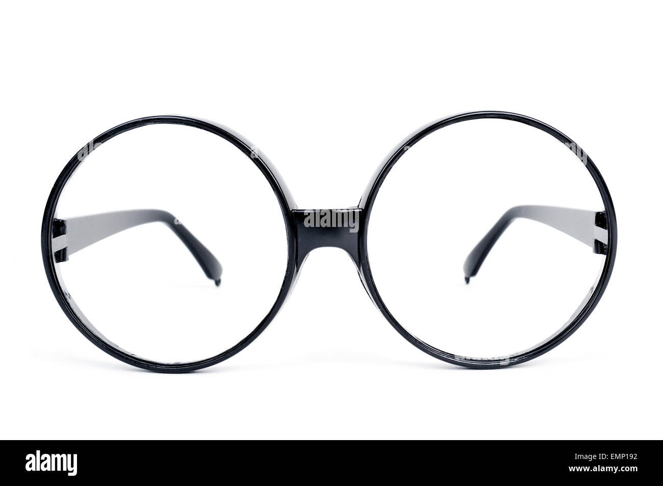 closeup of a pair of round-lens eyeglasses on a white background - Stock Image