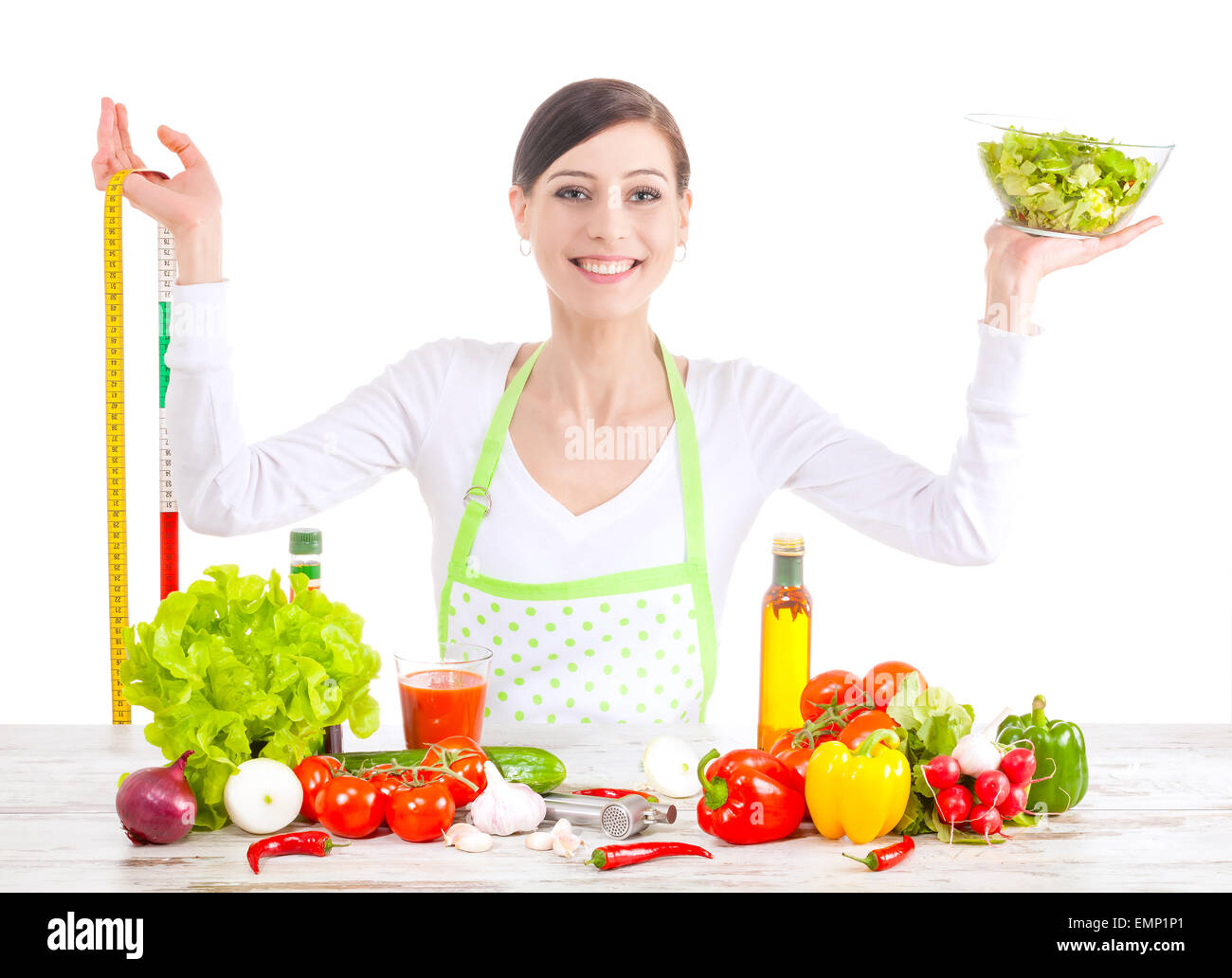 Young happy woman with salad and measuring tape, healthy food and diet concept. - Stock Image