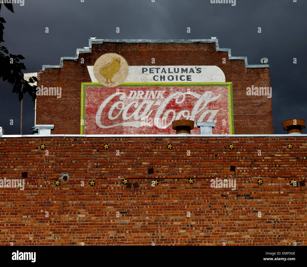 Old painted Coca Cola advert on the side of a building in