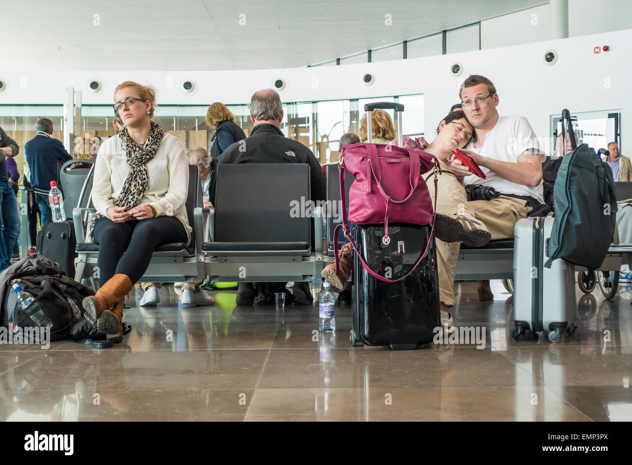 Gibraltar Airport Flight Delay Passengers in Departure Lounge - Stock Image