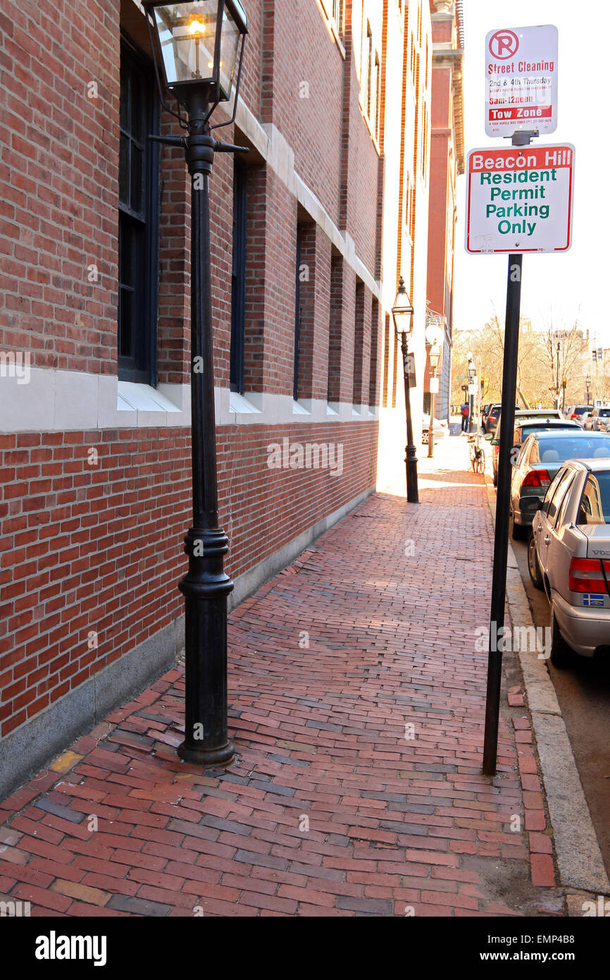 Boston Massachusetts Beacon Hill brick sidewalk with street lamp and parking sign. - Stock Image