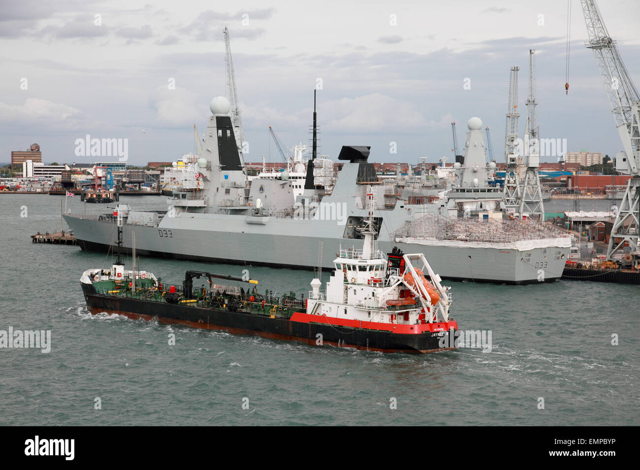 Oil products tanker Jaynee W and D33 HMS Dauntless in Portsmouth Harbour, Hampshire, England, UK - Stock Image
