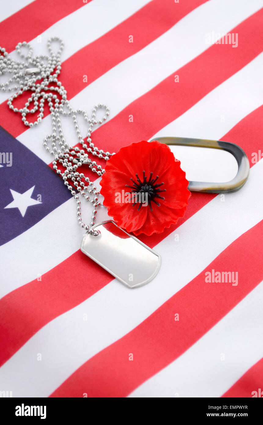 Usa memorial day concept with dog tags and red remembrance poppy on usa memorial day concept with dog tags and red remembrance poppy on american stars and stripes flag publicscrutiny Gallery