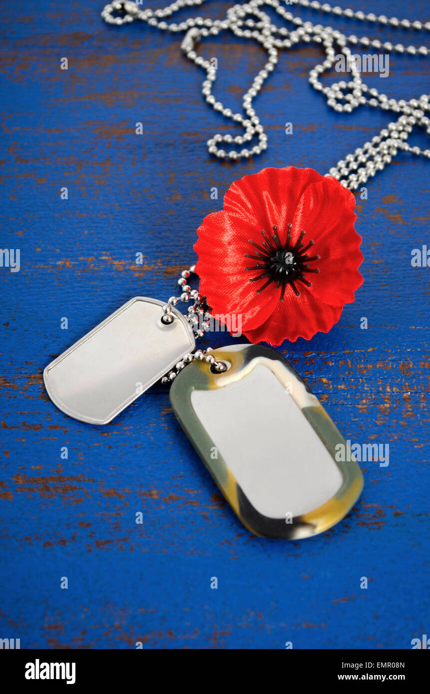 Usa memorial day concept of red remembrance poppy on dark blue stock usa memorial day concept of red remembrance poppy on dark blue vintage distressed wood table with soldiers dog tags publicscrutiny Gallery