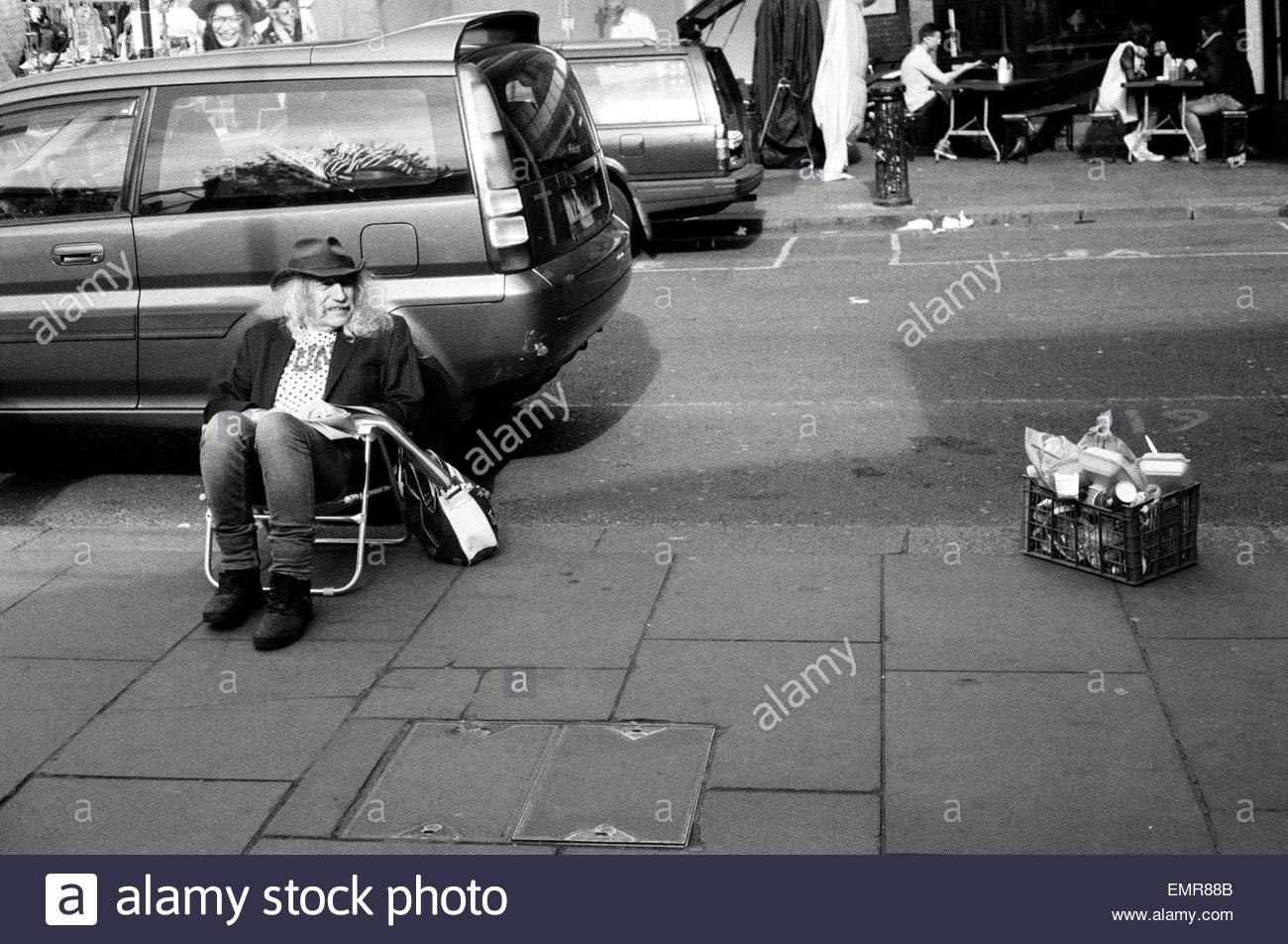 A market trader sits at  Portobello Green on Portobello Road, Notting Hill London, England UK. - Stock Image