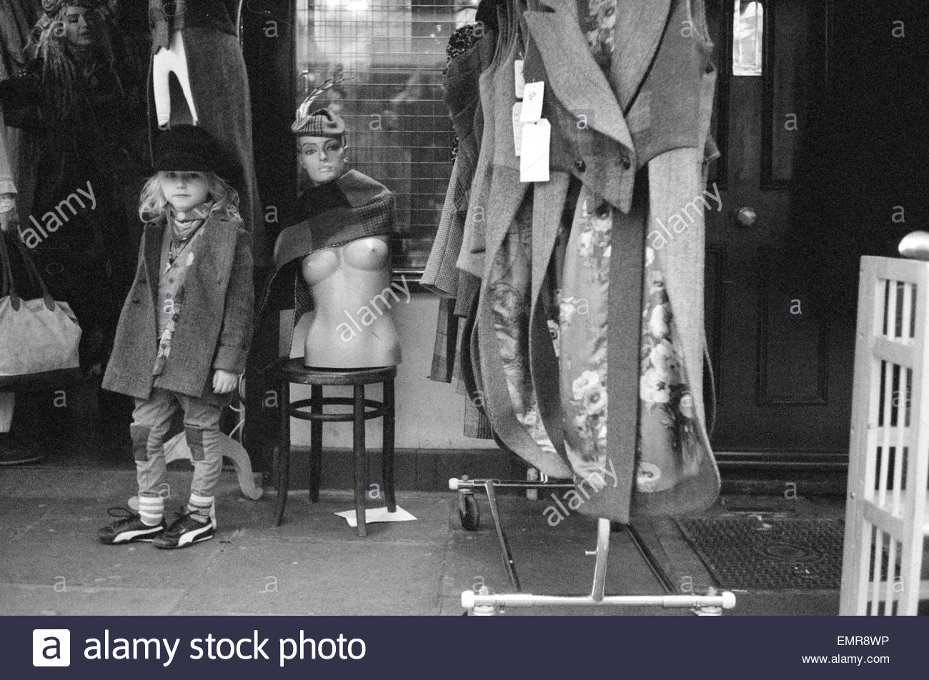 A young boy pose out side a vintage clothes store on Portobello Road, Notting Hill London Street Style Fashion. - Stock Image