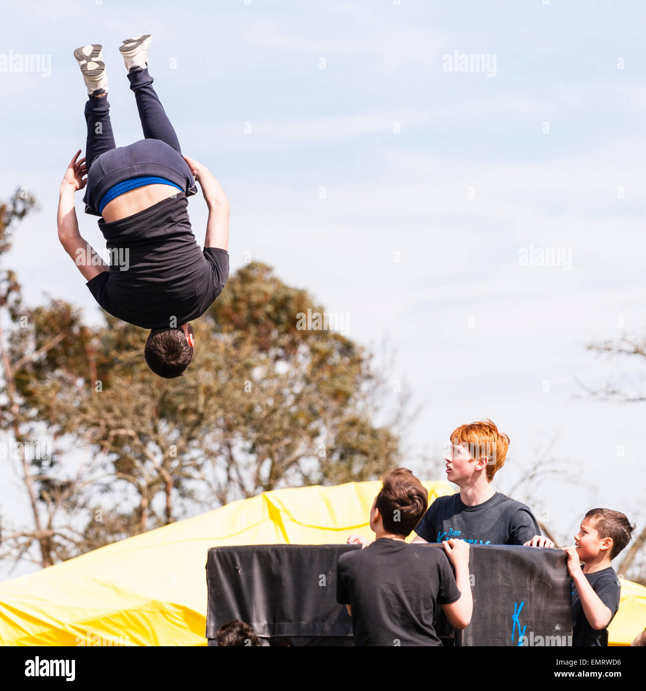 A Free runner demonstrating Parkour at Framlingham Country Show in Framlingham , Suffolk , England , Britain , Uk - Stock Image