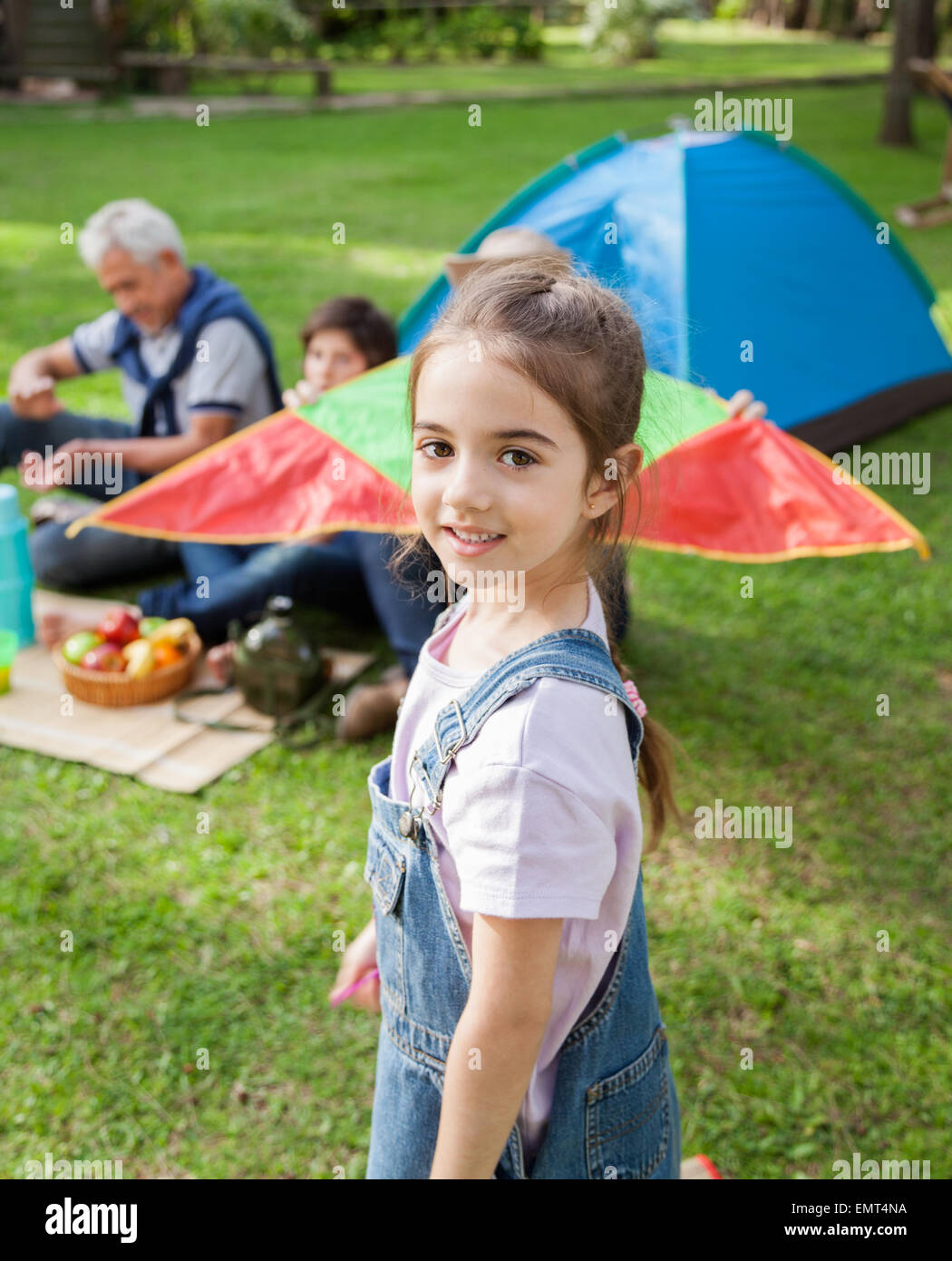 Smiling Girl Standing At Campsite - Stock Image