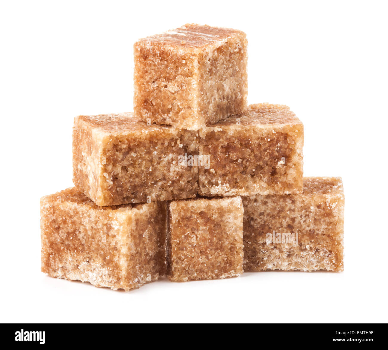 Brown cane sugar cubes isolated on white background - Stock Image