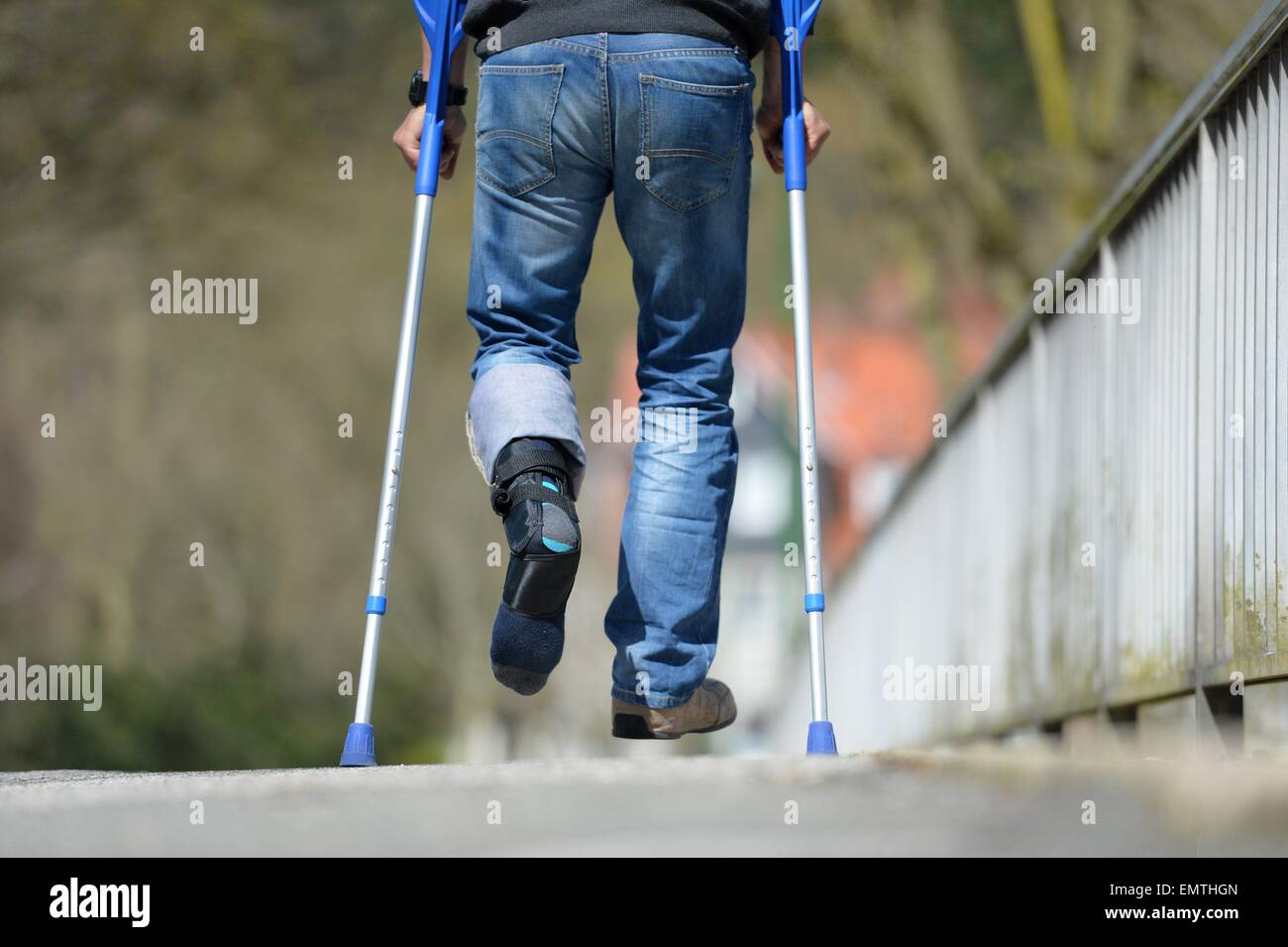 Man with crutches, Germany, city of Osterode, 15. April 2015. Photo: Frank May/picture alliance Stock Photo