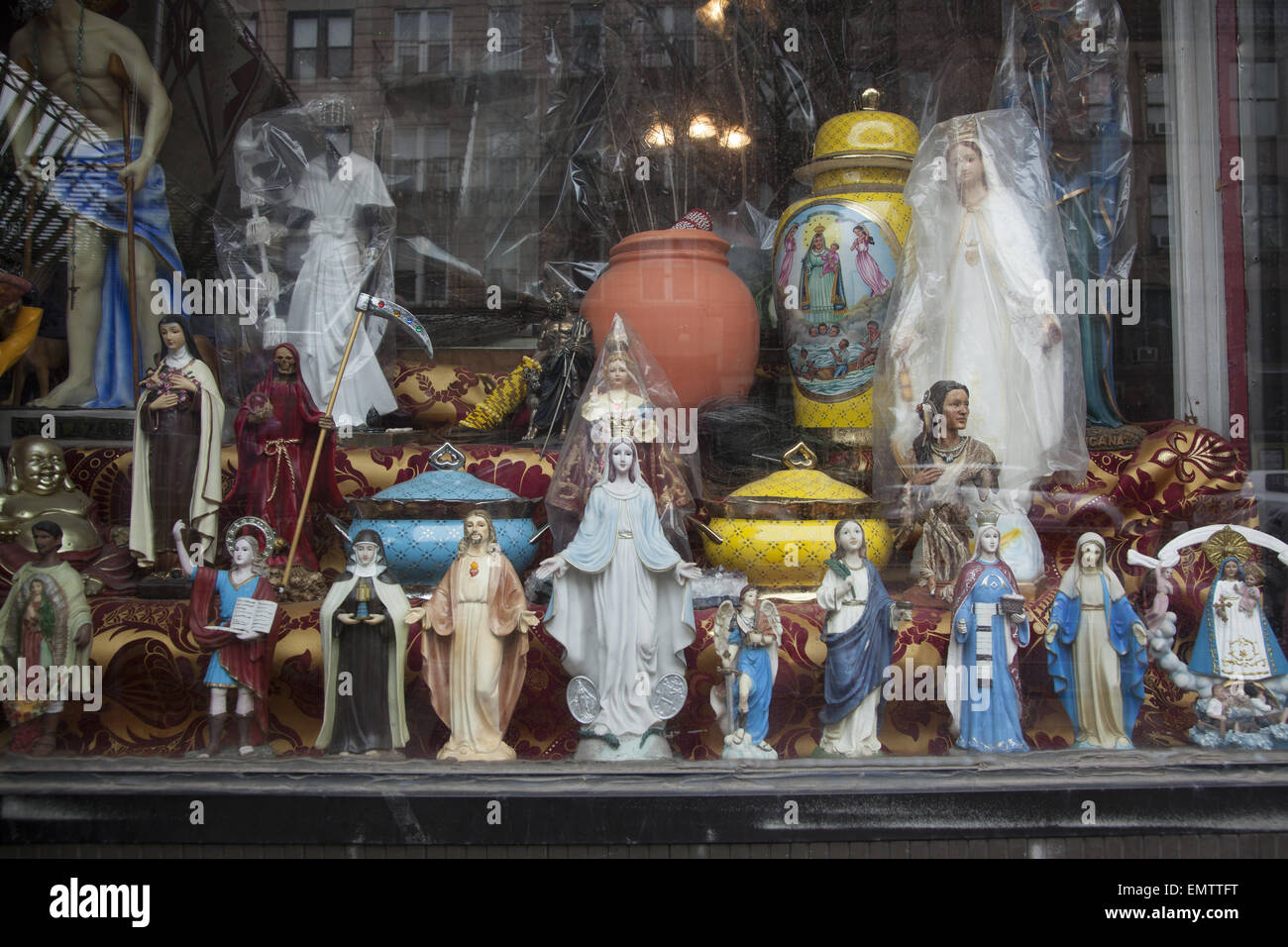 Store that sells religious statuary and other items for religious devotional practice. - Stock Image