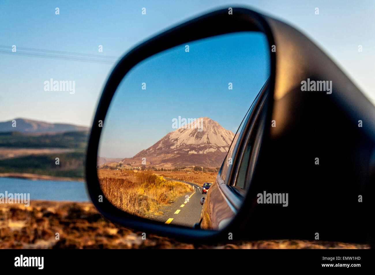 Mount Errigal, reflected in car wing mirror, An Earagail,  a 751-metre (2,464 ft) mountain near Gweedore in County - Stock Image