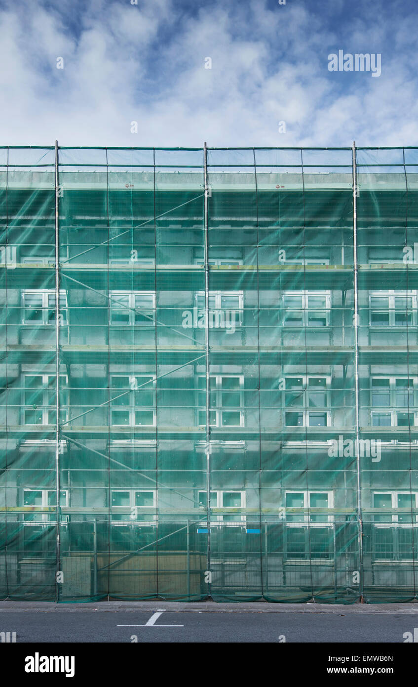 Scaffolding covering a house in construction - Stock Image