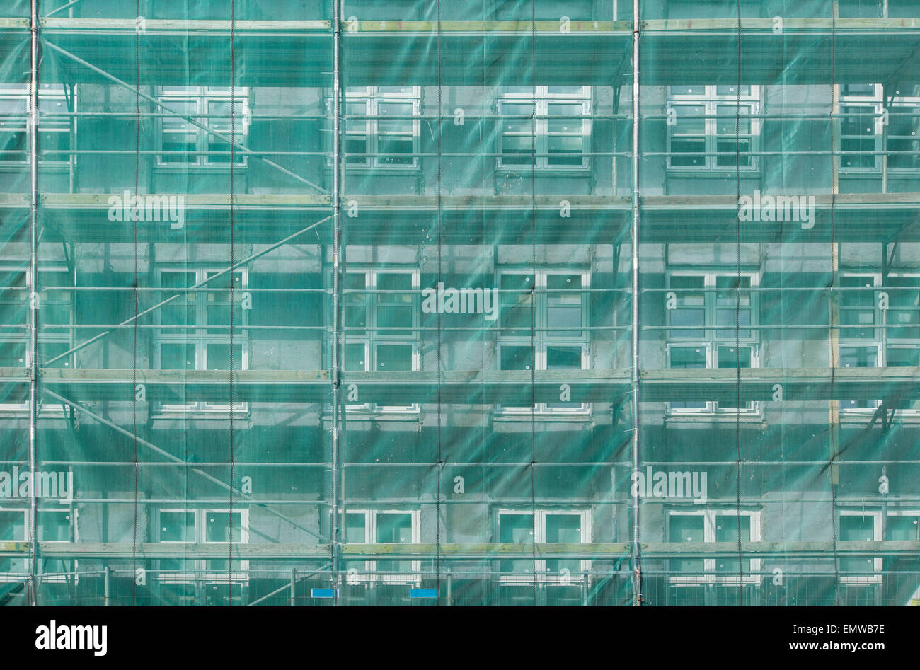 Scaffolding covering a house during building stage - Stock Image