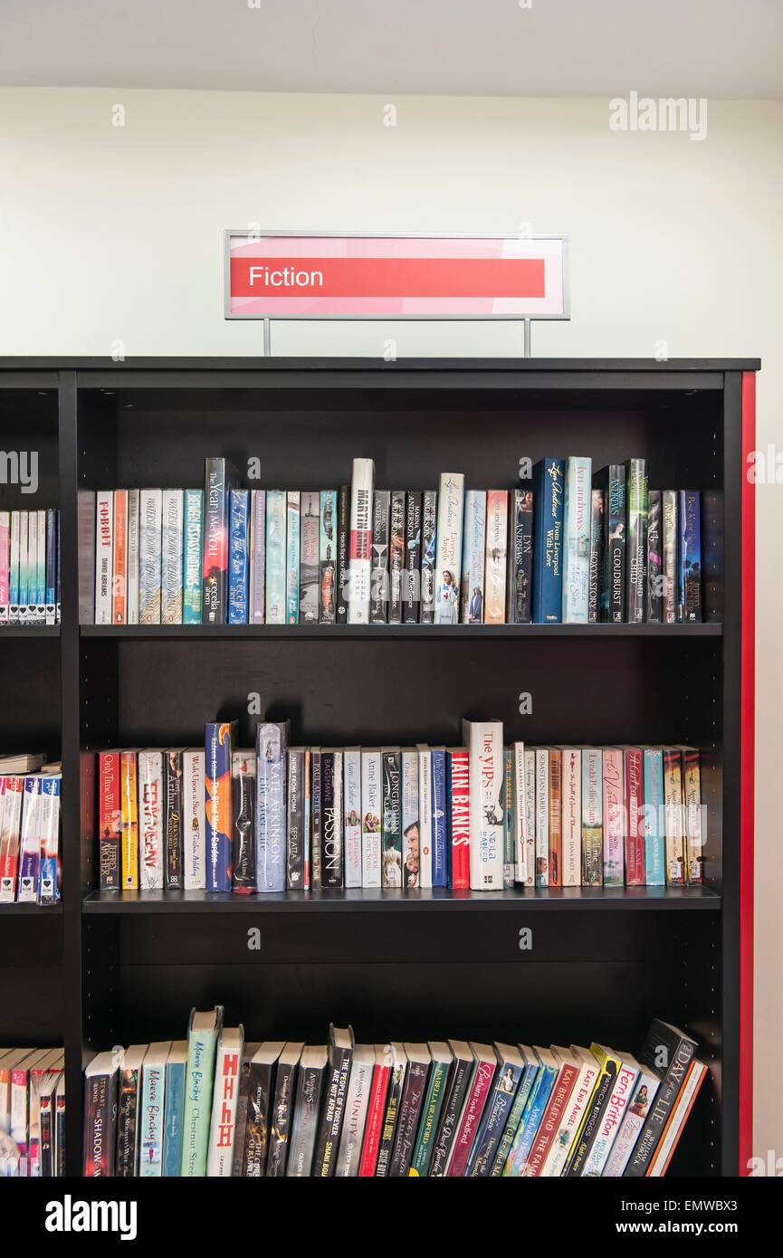 Shelves of library books at the Harlesden library in the london borough of Brent , fiction - Stock Image