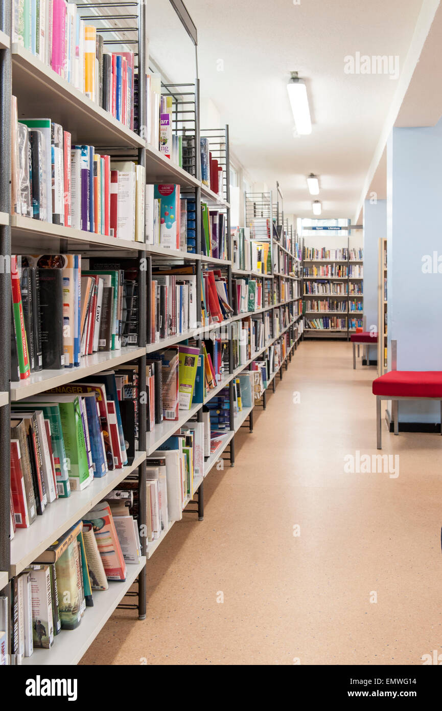 Shelves full of books at the library in Ealing Road Library in the borough of Brent Council in london - Stock Image