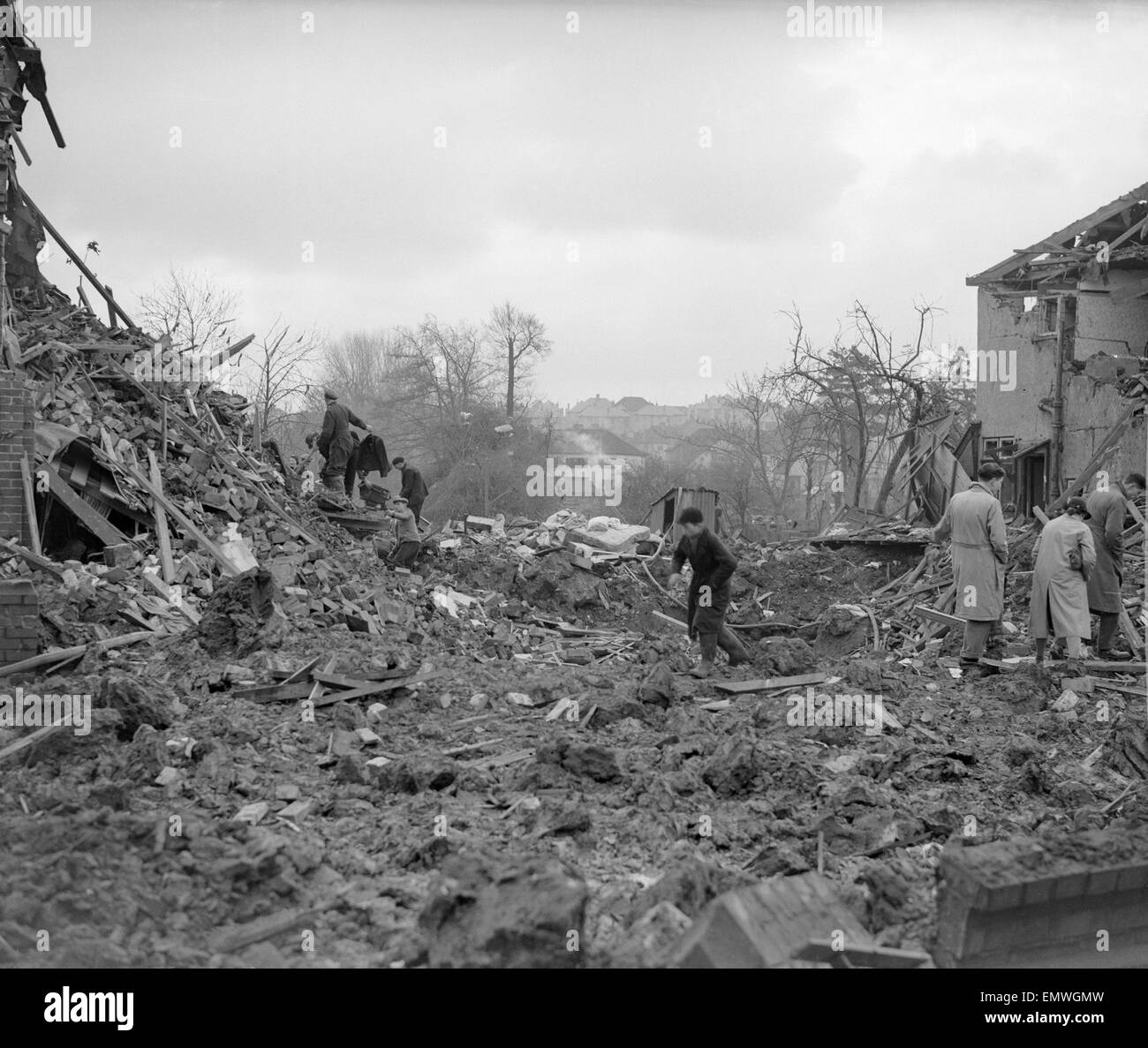 Air Raid Damage in Bristol Civilians searching through rubble of their bomb damaged houses after an air raid on - Stock Image