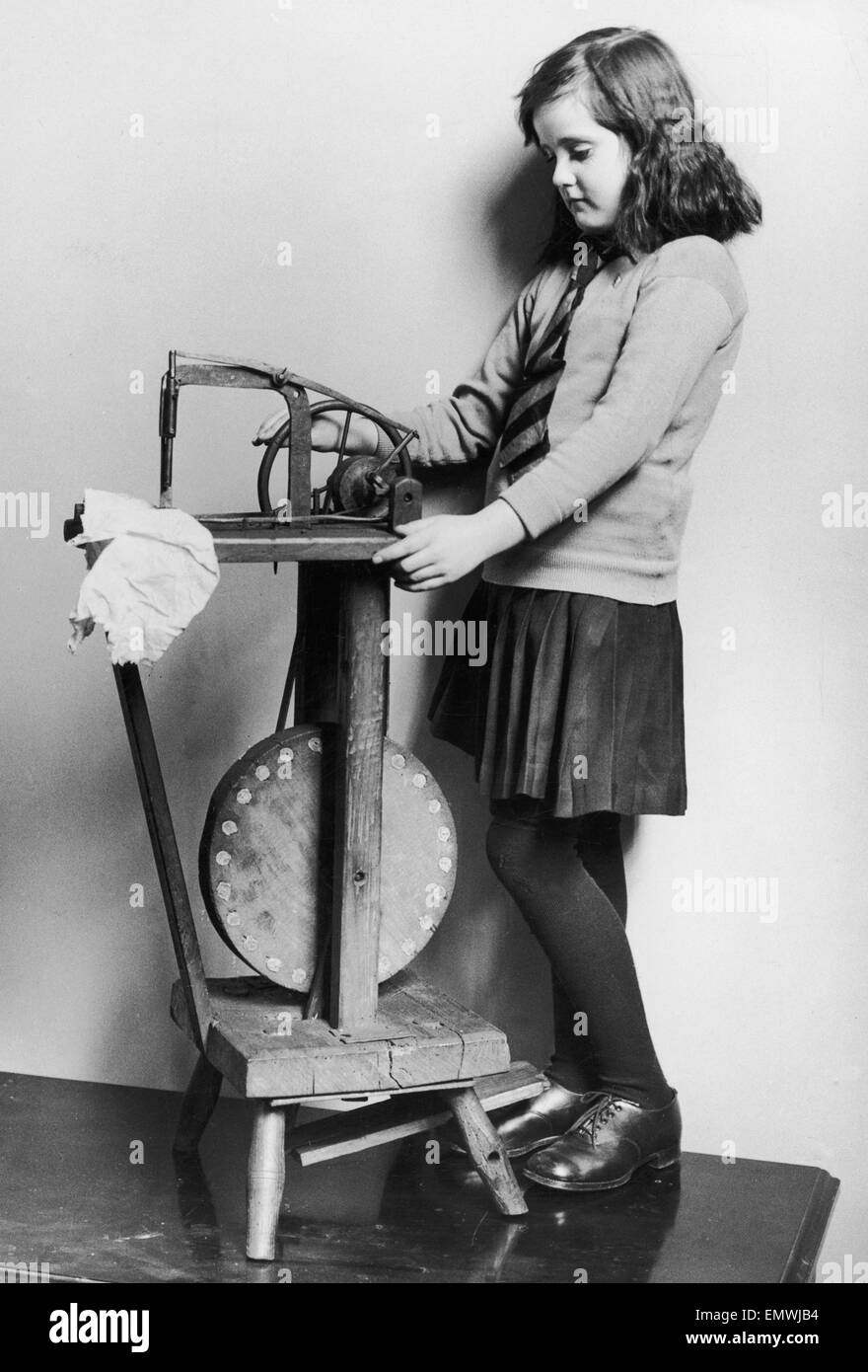 Corinne Griffith seen here in the role of Mary Boyne sitting working at a Singer sewing machine in the film The - Stock Image