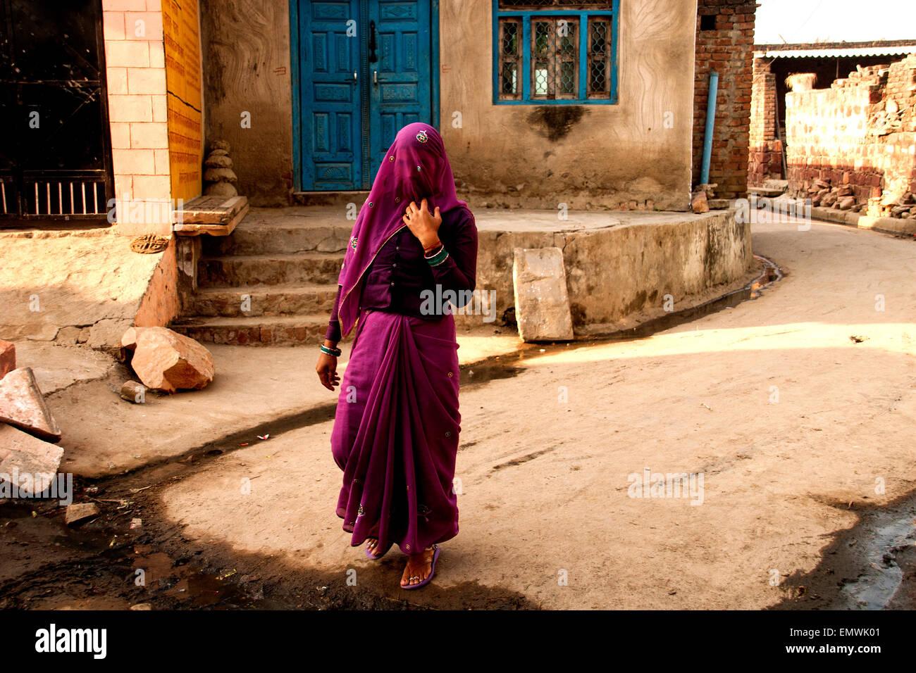 Agra, India. Street scene depicts local woman in Sari - Stock Image