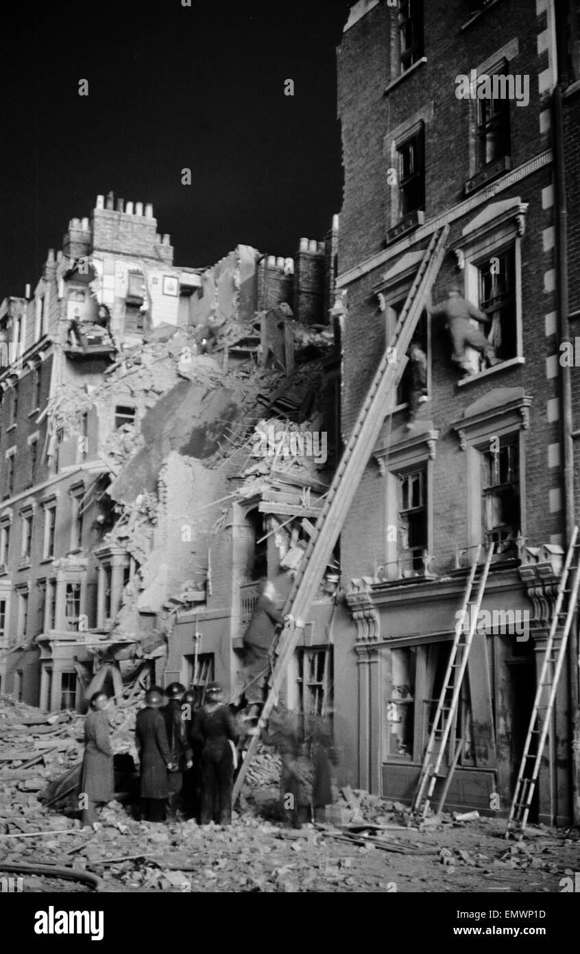 Firemen rescuing people from their house on Tabernacle St, Shoreditch. 11th January 1941. - Stock Image