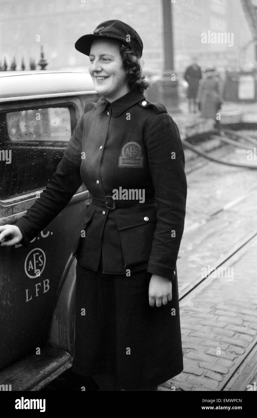Miss Gillian Tanner awarded the George medal after fire at Taylor Depositary, Elephant and Castle, 31 January 1941 - Stock Image