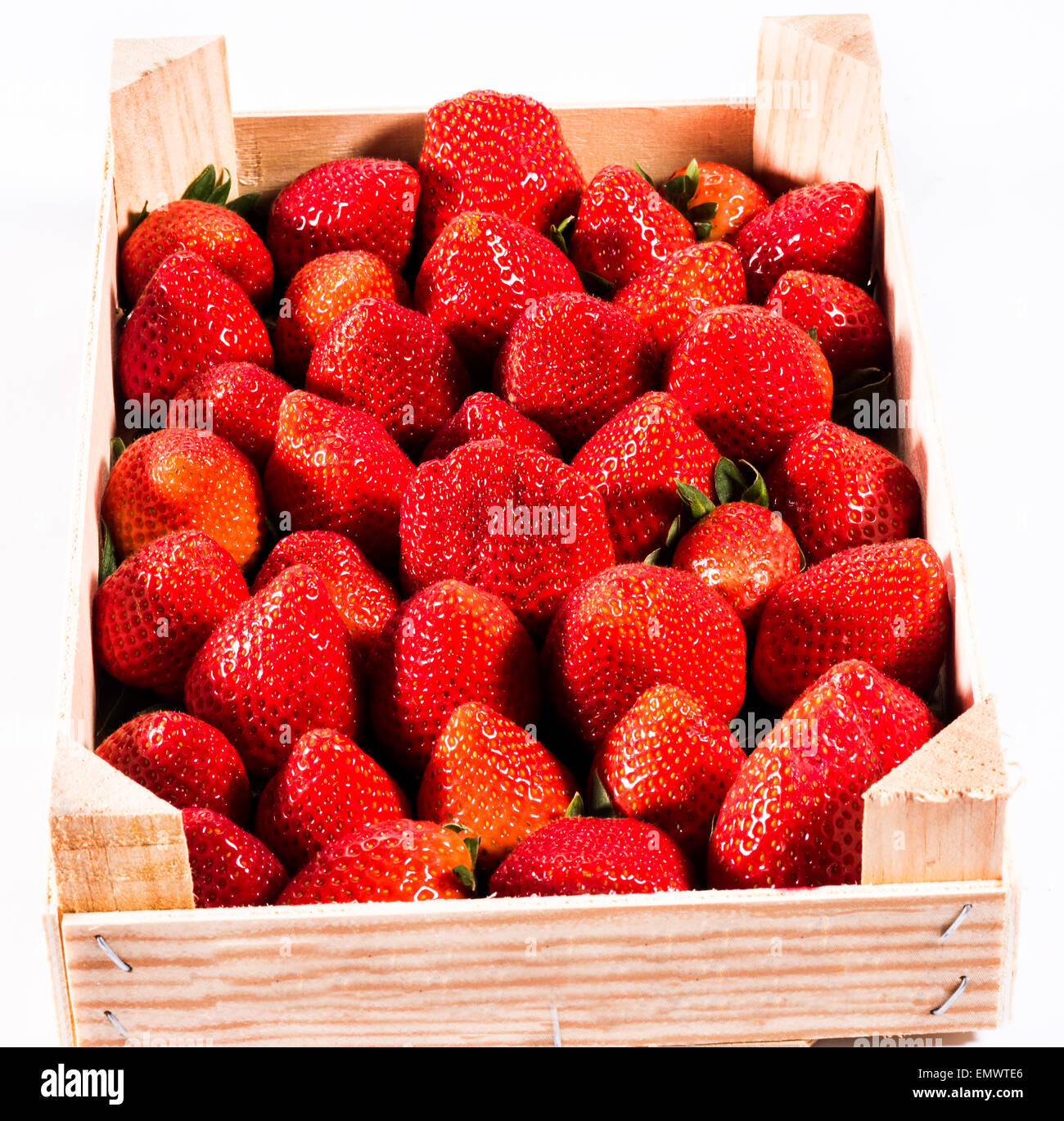 Strawberry, fresh strawberries in the wooden box in an ecological nature healthy food fruit valuable red biodynamic - Stock Image