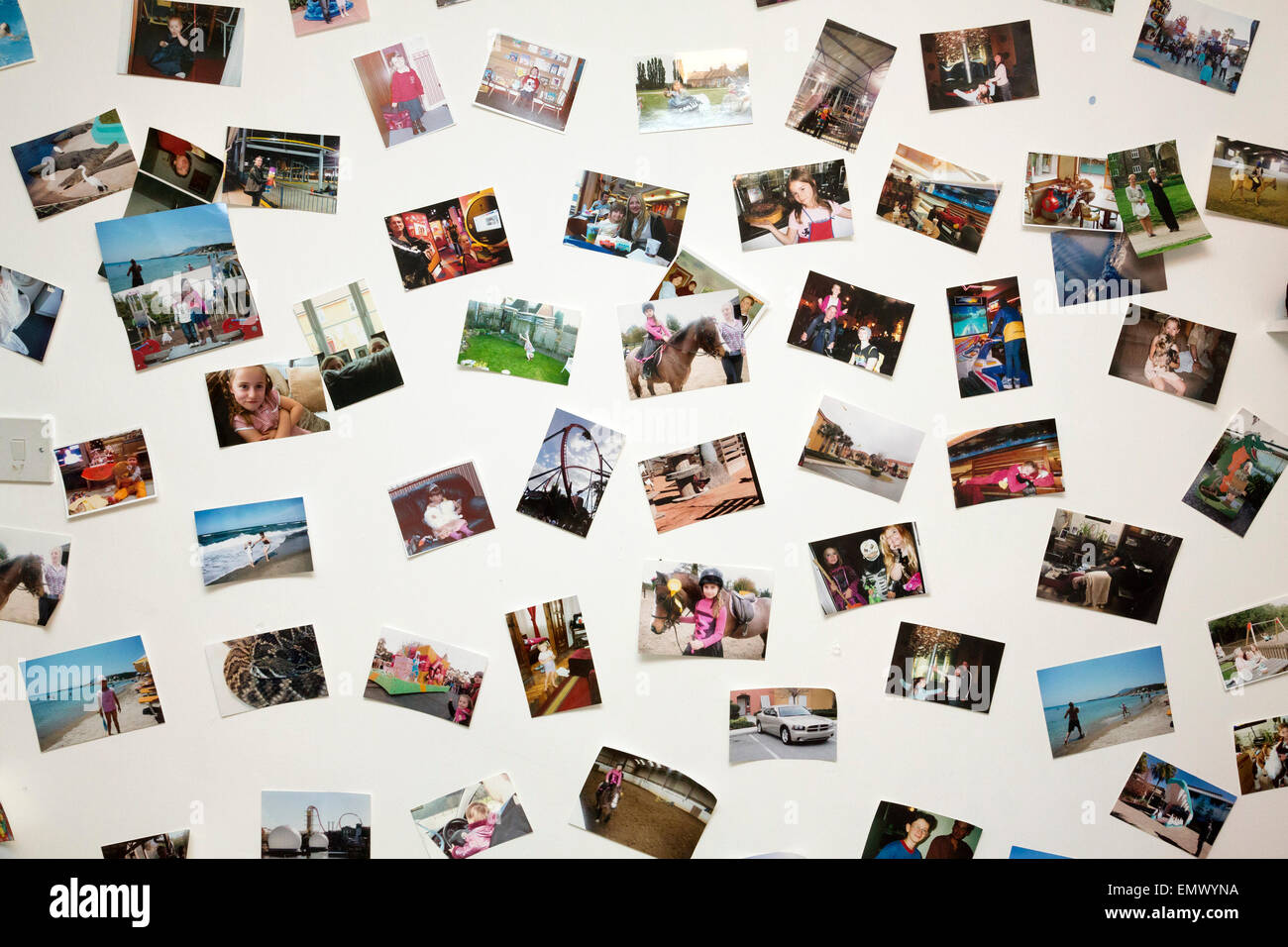 collection of photos on wall - Stock Image