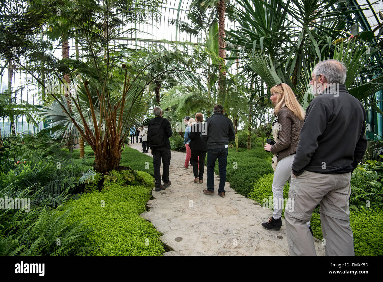 Tourists visiting the Royal Greenhouses of Laeken in Art Nouveau style in the park of the Royal Palace near Brussels, - Stock Image