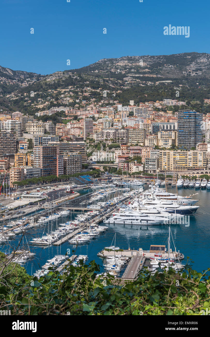View from Monaco Ville across Port Hercule towards Monte Carlo on a sunny day - Stock Image