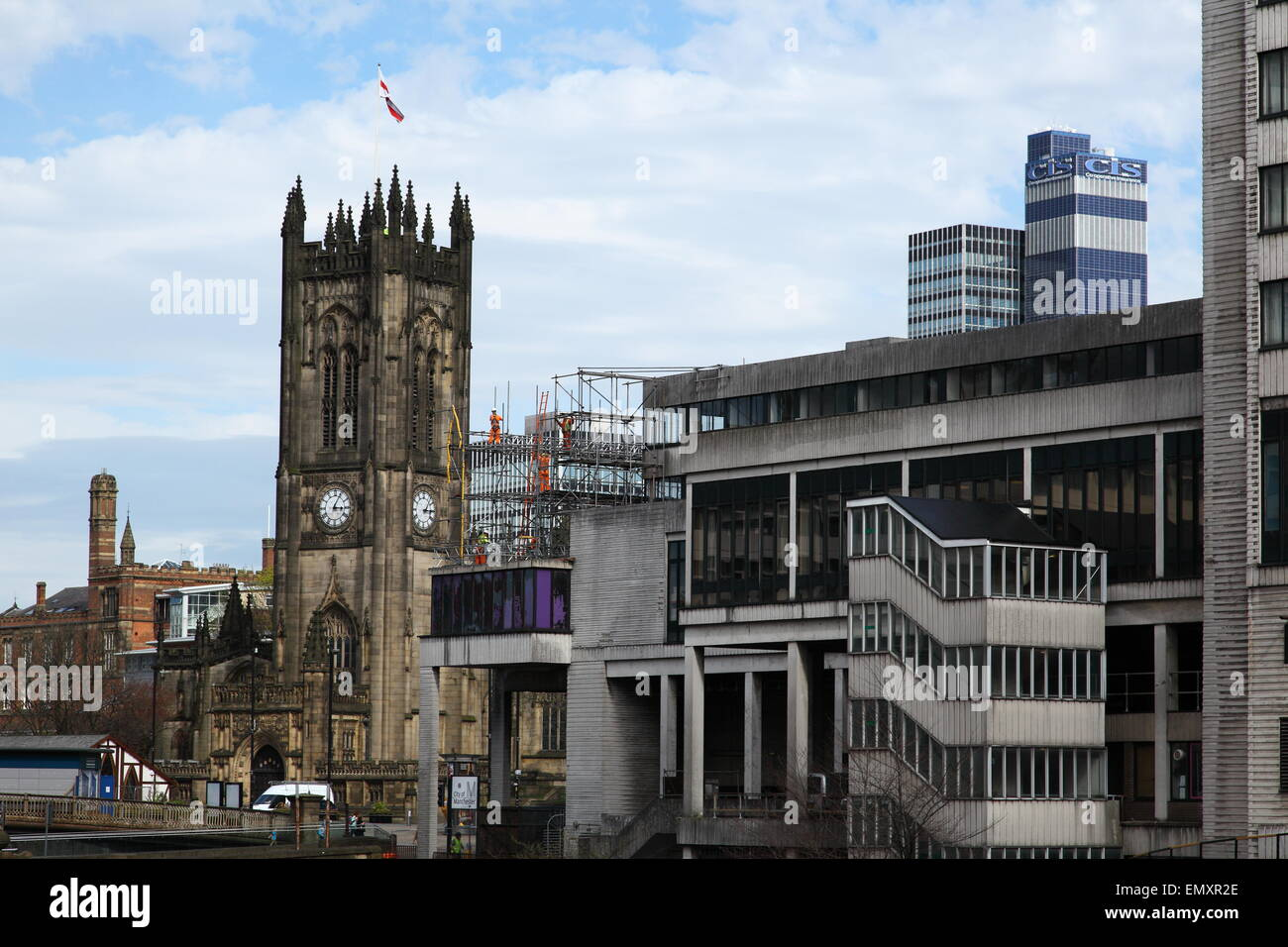 Workers dismantling scaffolding in the shadow of the cathedral in Manchester city centre, England UK - Stock Image