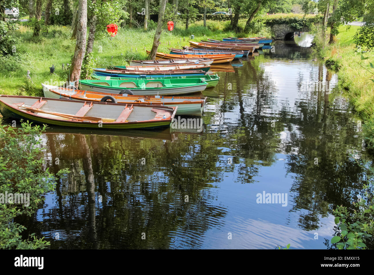 Rowing boats on a peaceful river in Killarney, County Kerry, Ireland - Stock Image
