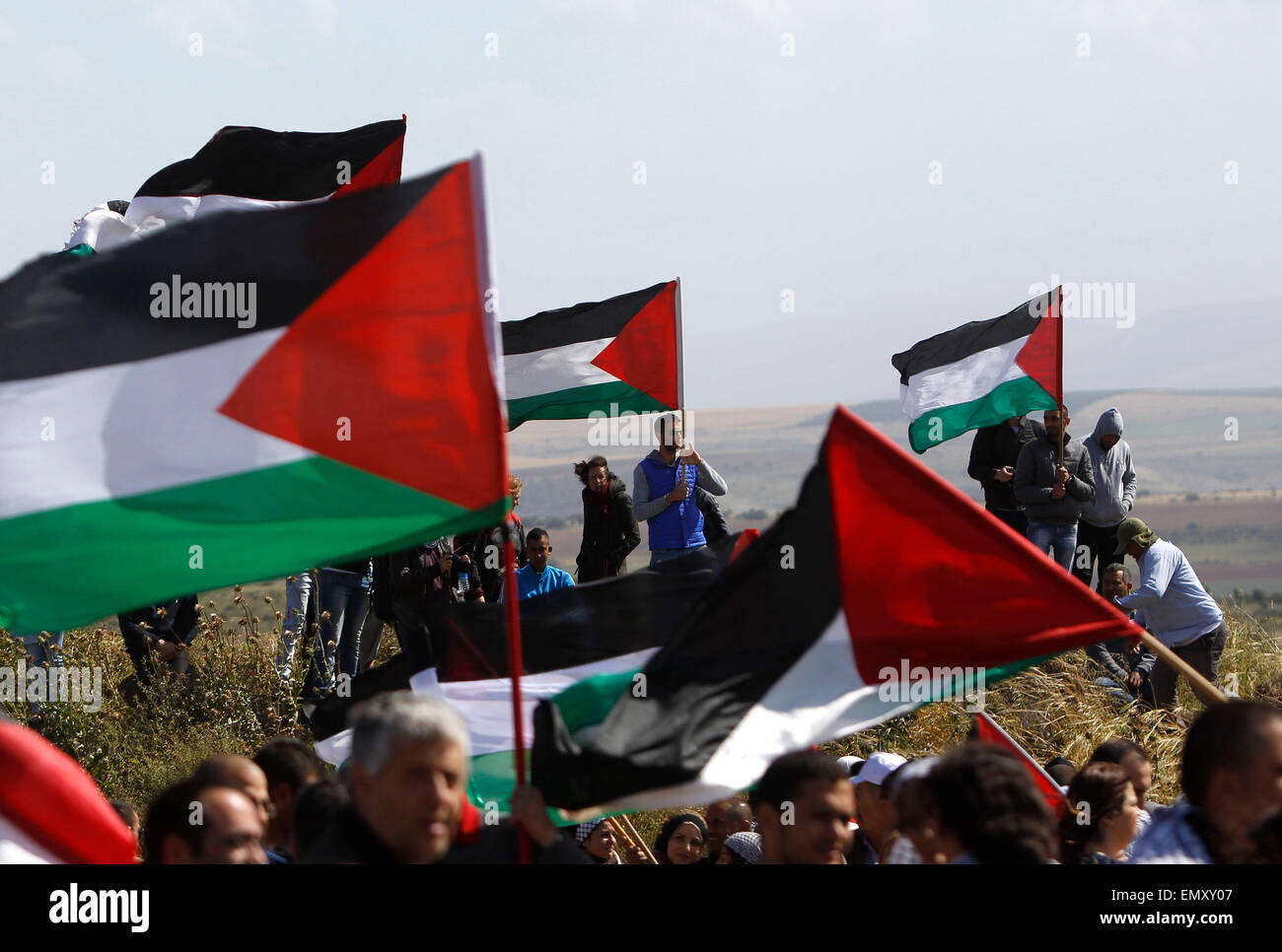 Jerusalem, Israel. 23rd Apr, 2015. Israeli Arabs and other supporters wave Palestinian flags during a protest to - Stock Image