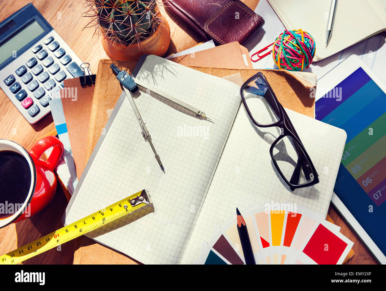 Messy Designer's Table with Tools - Stock Image