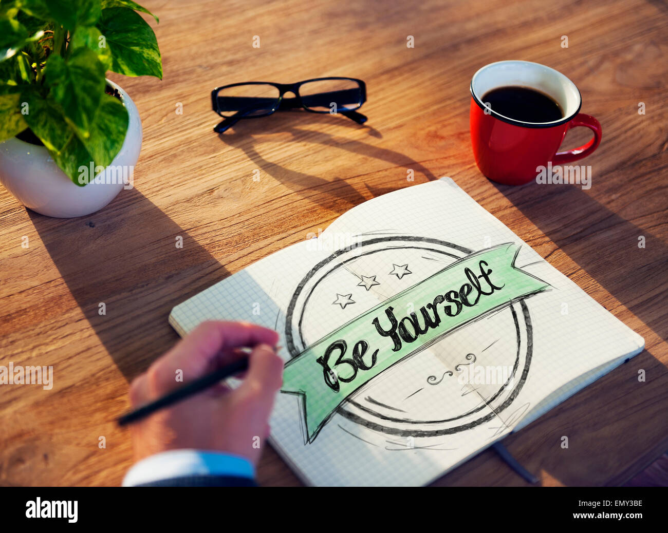 Businessman Writing the Words 'Be Yourself' - Stock Image