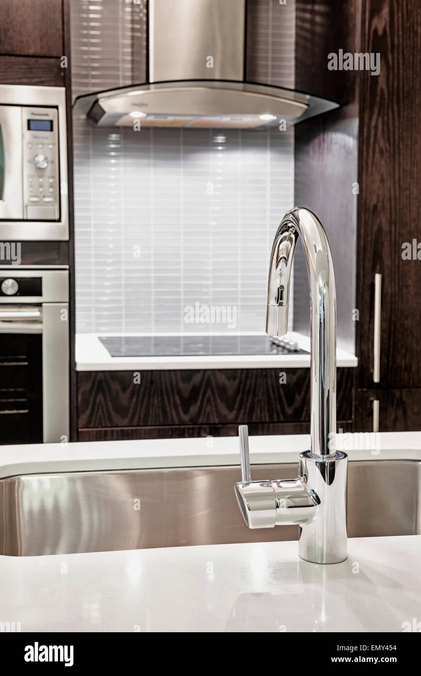 Picture of: Elegant Faucet And Sink In Island Counter Of Modern Kitchen Stock Photo Alamy