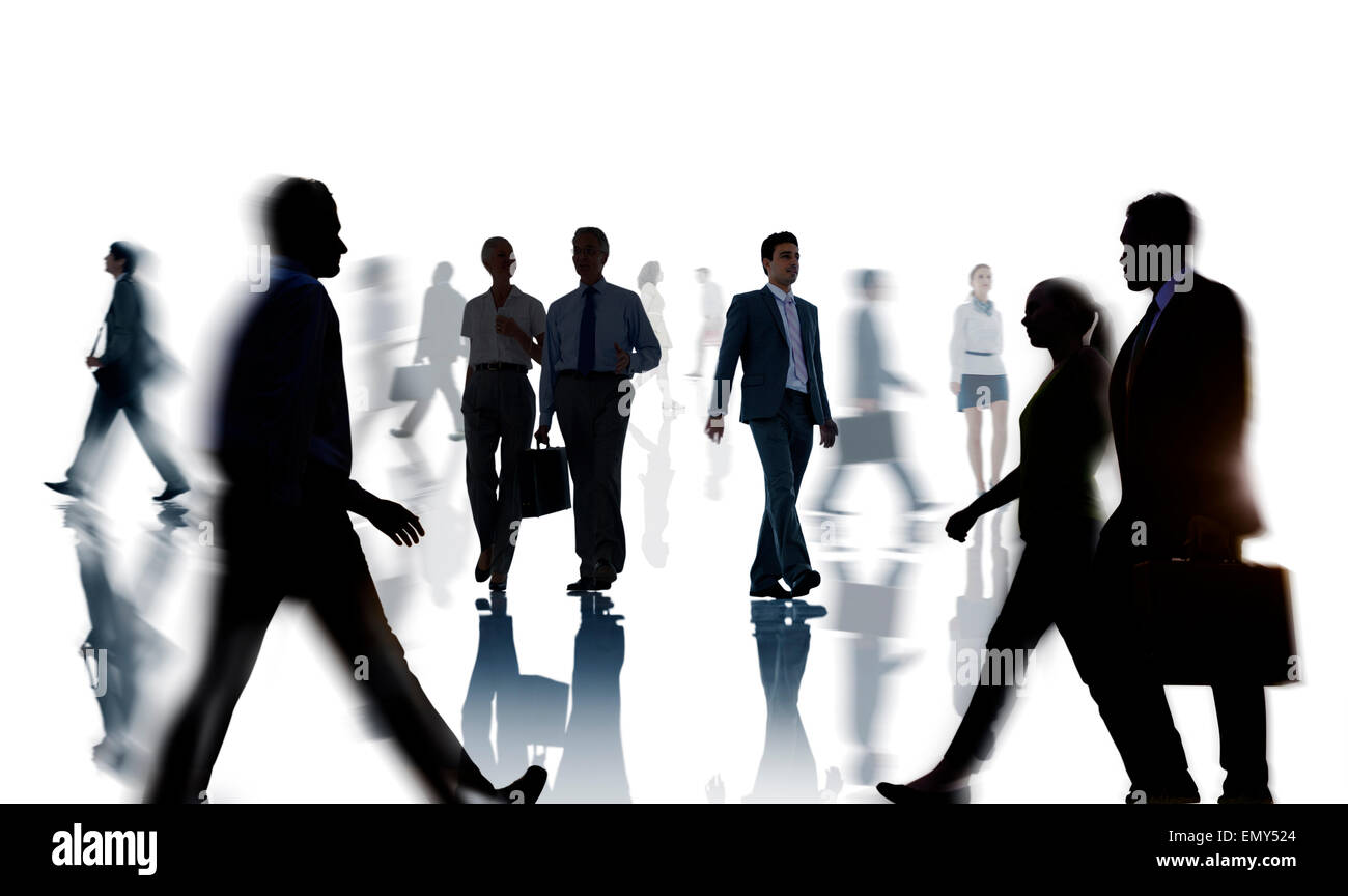 Silhouettes of Business People Rush Hour - Stock Image