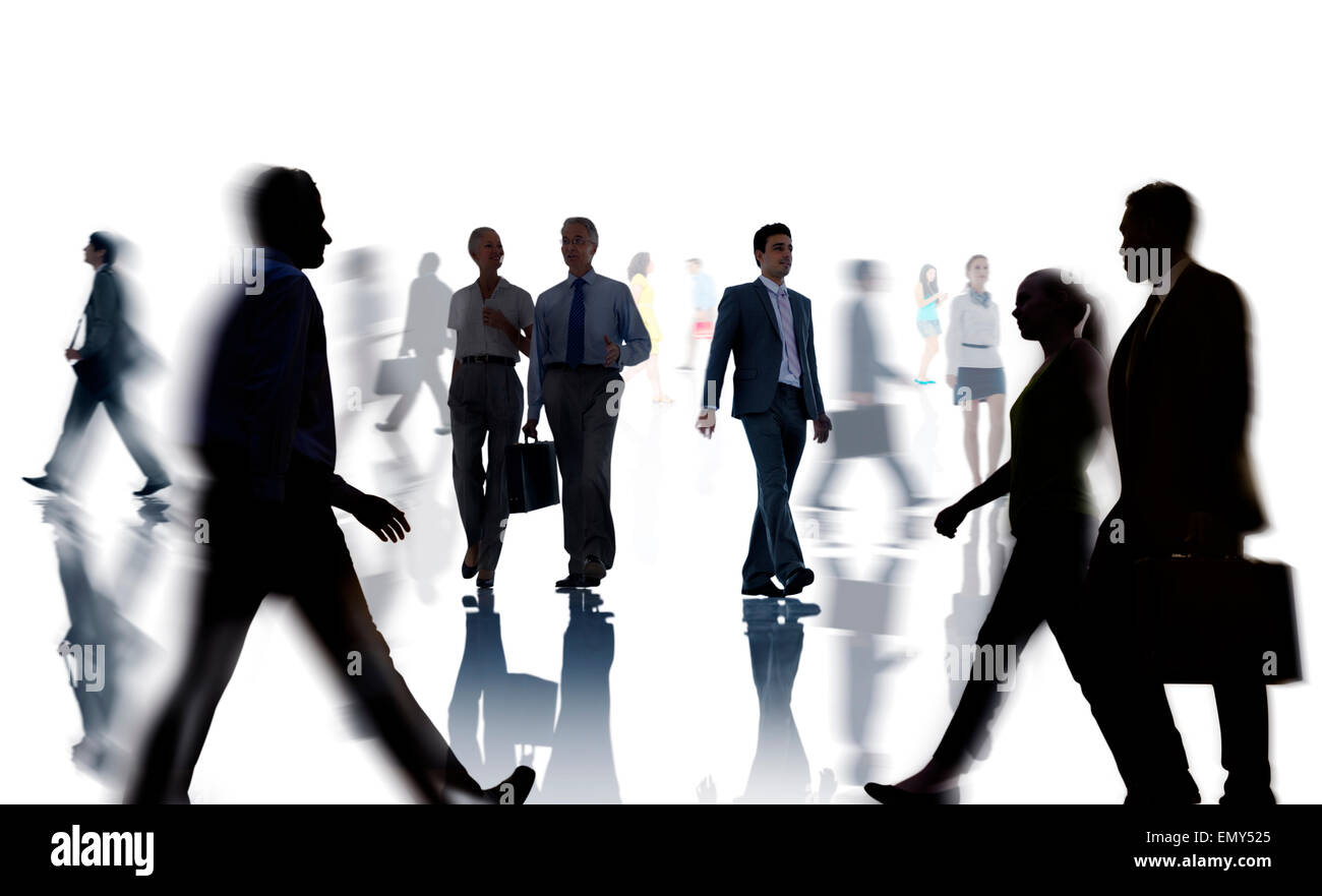 Silhouettes of Business and Casual People Walking - Stock Image