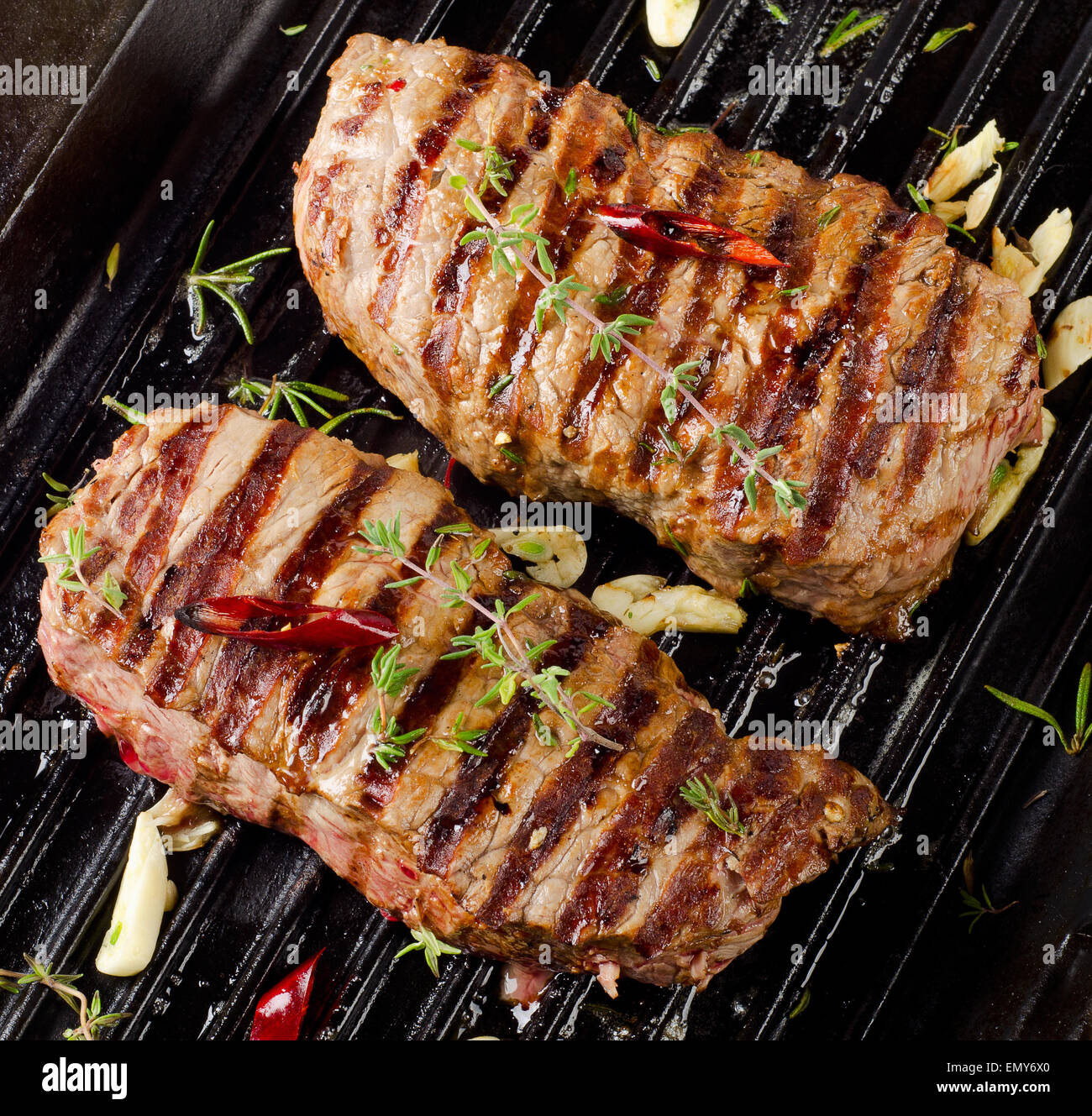 Grilled Beef steak with fresh herbs . Selective focus - Stock Image