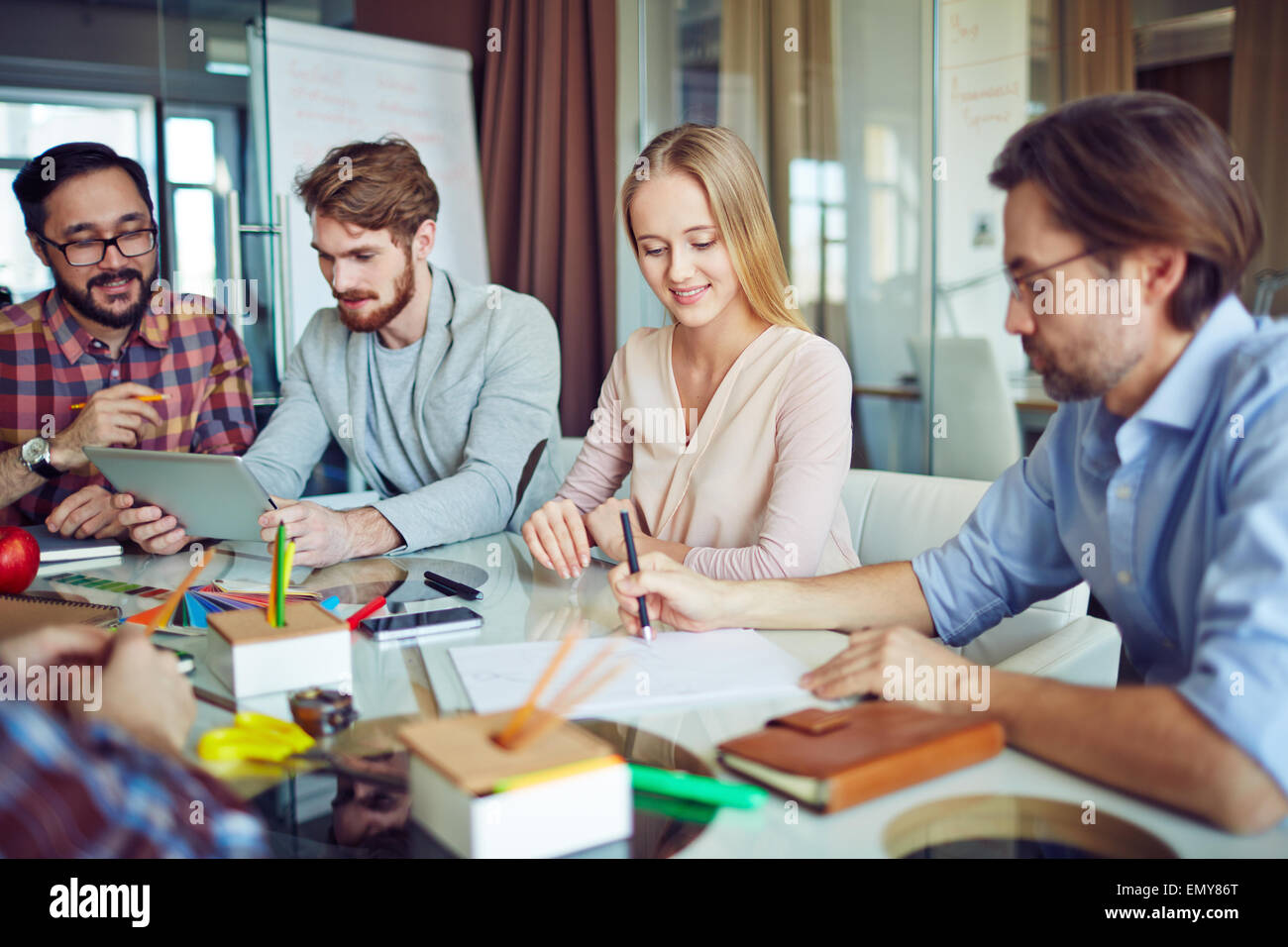 Business group planning work in office - Stock Image