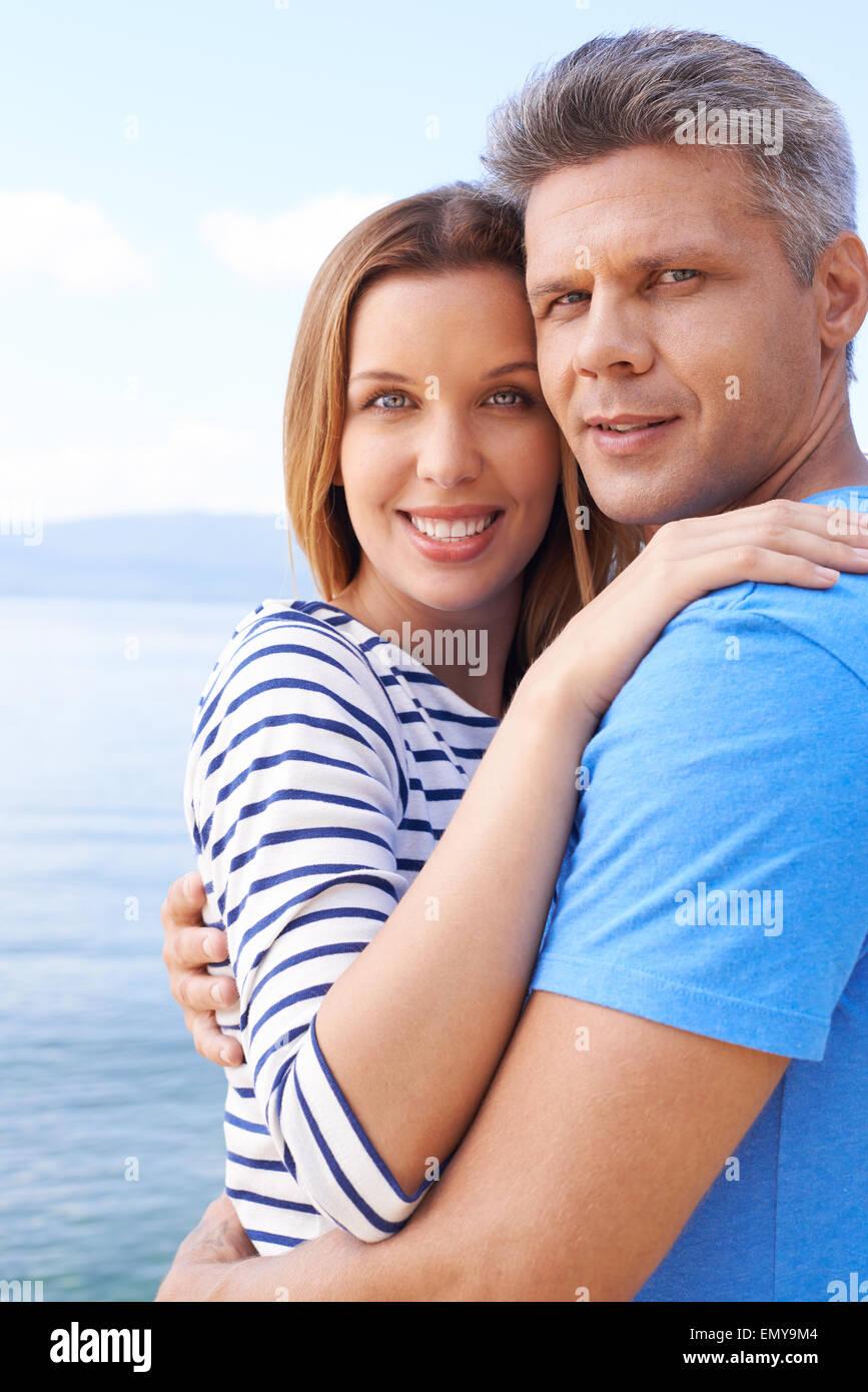 Amorous couple in embrace enjoying summer vacation - Stock Image
