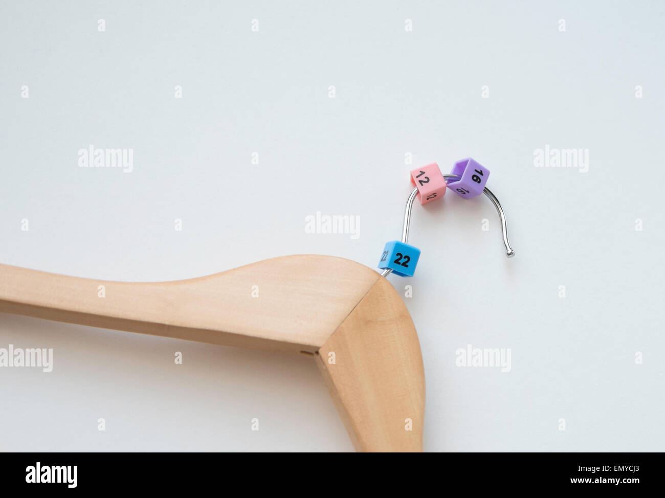 Different sizes on coathanger - Stock Image